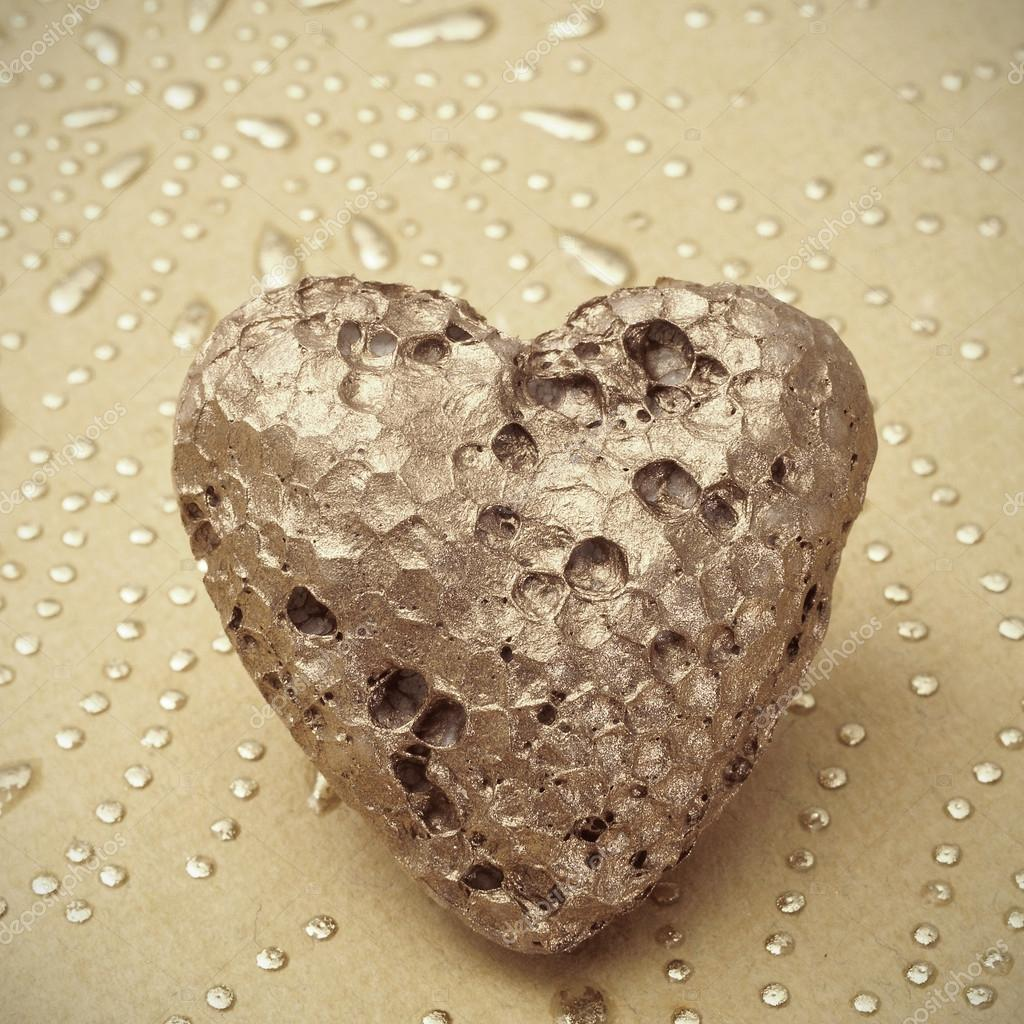 Golden heart on a textured background  Stock Photo #17167253
