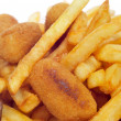 Stock Photo: Spanish combo platter with croquettes, calamares and french frie