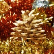 Pine cone and tinsel — Stock Photo
