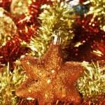 Christmas star, balls and tinsel — Stock Photo