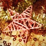 Christmas star and tinsel — Stock Photo