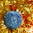Christmas ball and tinsel — Stock Photo