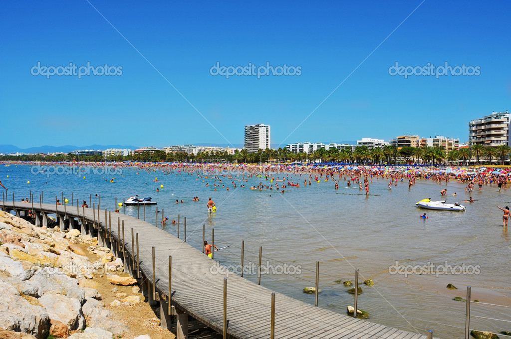 SALOU, SPAIN - AUGUST 10: Vacationers in Llevant Beach on August 10, 2012 in Salou, Spain. Salou is a major destination for sun and beach for European tourism with more than 50,000 accommodations  Stock Photo #18248129