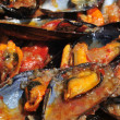 Mejillones a la marinera, spanish mussels in marinara sauce — Stock Photo