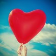 Red heart-shaped balloon — Stock Photo #19150929