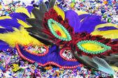Carnival masks and confetti — Stock Photo