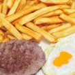 Stock Photo: Combo platter with fried egg, burger and french fries
