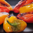 Roasted sweet bite peppers of different colors — Stock Photo