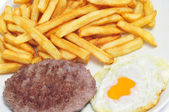 Combo platter with fried egg, burger and french fries — Stock Photo