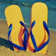 Flip-flops on the sand of a beach - Zdjęcie stockowe