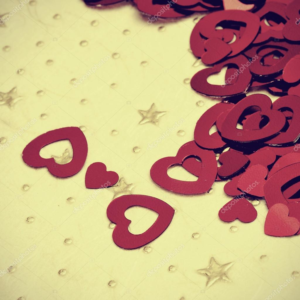 A pile of red hearts on a textured background, with a retro effect — Stock Photo #19943993