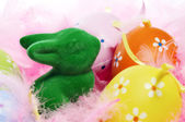 Easter bunny and eggs and feathers — Stock Photo