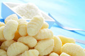Gnocchi and parmesan cheese — Stock Photo