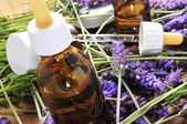 Aromatherapy oil and lavender flowers — Stock Photo
