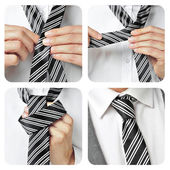 A man knotting his tie — Stock Photo