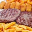 Stock Photo: Spanish combo platter with burgers, croquettes, calamares and fr