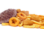 Spanish fattening food: burgers, croquettes, calamares and frenc — Stock Photo