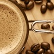 Постер, плакат: Cup of coffee and coffee beans