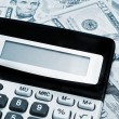 Royalty-Free Stock Photo: Calculator and dollars