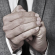 Man in suit rubbing his hands — Stock Photo