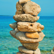 Balanced stones on the beach in the summer — Stok fotoğraf