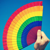 Gay hand fan — Stock Photo