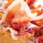 Spanish pinchos de jamon, serrano ham served on bread — Stock Photo #27895223