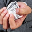 Man in suit with a crumpled piece of paper — Stock Photo