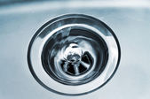 Swirl water in a drain — Stock Photo