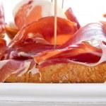 Spanish pinchos de jamon, serrano ham served on bread — Stock Photo