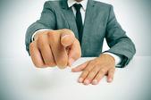 Man in suit pointing the finger — Stock Photo