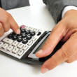 Businessman using a calculator — Stockfoto