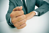 Man in suit banging his fist on the desk — Stock Photo