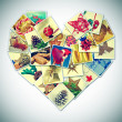 Stock Photo: Heart-shaped christmas pictures collage