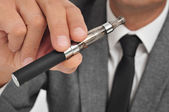 Vaping with an electronic cigarette — Stock Photo