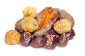 Panellets and roasted chestnuts and sweet potatoes, typical snac — Stock Photo