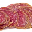 Slices of fuet, spanish cured sausage typical of Catalonia — Stock Photo #32842043