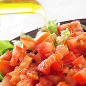 Salad with olive oil — Stock Photo