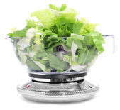 Salad leaves in a scale — Stock Photo