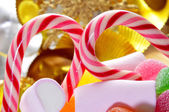 Candy canes and treats — Stock Photo
