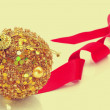 Christmas ball and ribbon — Stock Photo