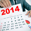 Man in suit with charts and a 2014 calendar — Foto Stock