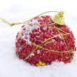 Red and golden christmas ball on the snow — Foto de Stock