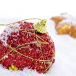 Christmas ornaments on the snow — Lizenzfreies Foto
