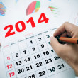 At the office with a 2014 calendar — Foto Stock