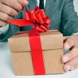 Man in suit opening a gift — Foto de Stock