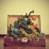 Christmas tree in a suitcase — Stock Photo
