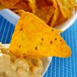 Tortilla chips and nacho cheese — Stock Photo