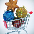 Christmas ornaments in a shopping cart — Stock Photo