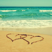Hearts in the sand of a beach — Stock Photo
